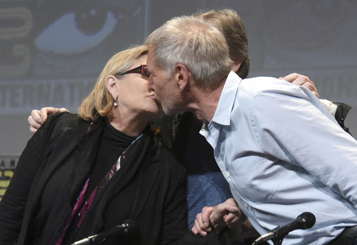 Carrie Fisher (left) and Harrison Ford kiss at the Comic-Con International in San Diego, Calif. in this July 10, 2015, file photo. (Photo by Richard Shotwell/Invision/AP)
