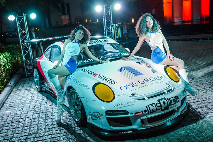 Two lovely grid girls pose with the Porsche 997 Generation One – GT3 from TR-Motorsport.