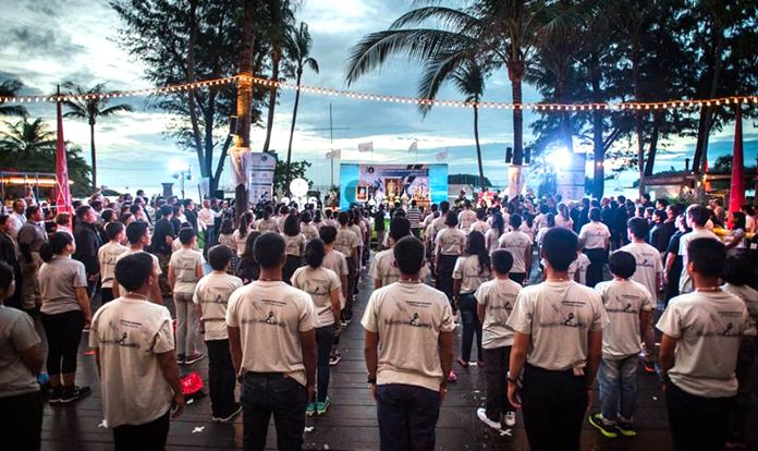 Youth sailors observe 89 seconds of silence in loving memory of the Regatta's founding patron, HM the late King Bhumibol Adulyadej.