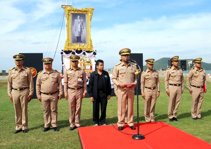Naval officers and Sattahip District Chief Noraset Sritapatso attend the ceremonial opening of the event.