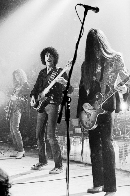 (L to R) Brian Robertson, Phil Lynott and Scott Gorham perform with Thin Lizzy at Bradford St Georges Hall in northern England, 24/11/1977. (Photo/Richard Marchewka/Public Domain)