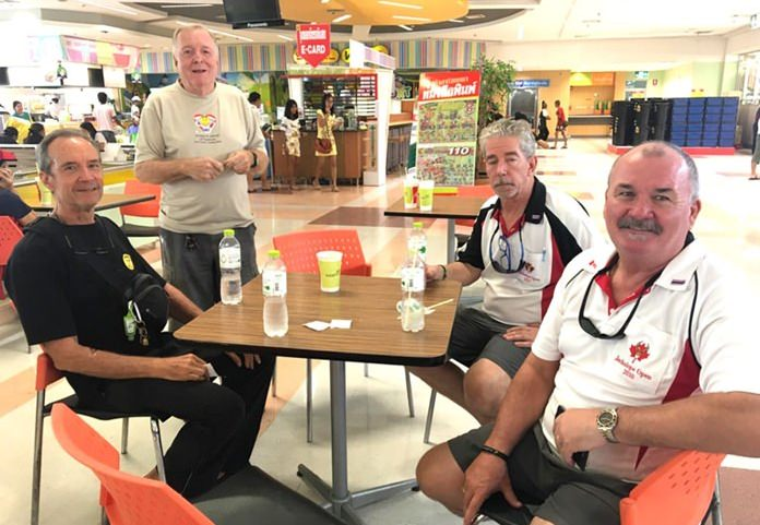 "(L to R) Woody, Erle, JD and Rob take a break during the Christmas shopping ""fun""."