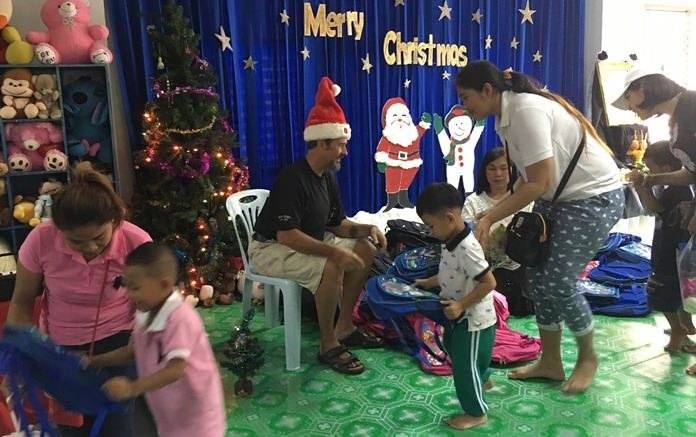 Santa Claus this year was portrayed by Jesters' Joake, who handed school bags to the children courtesy of the Jesters Care for Kids.