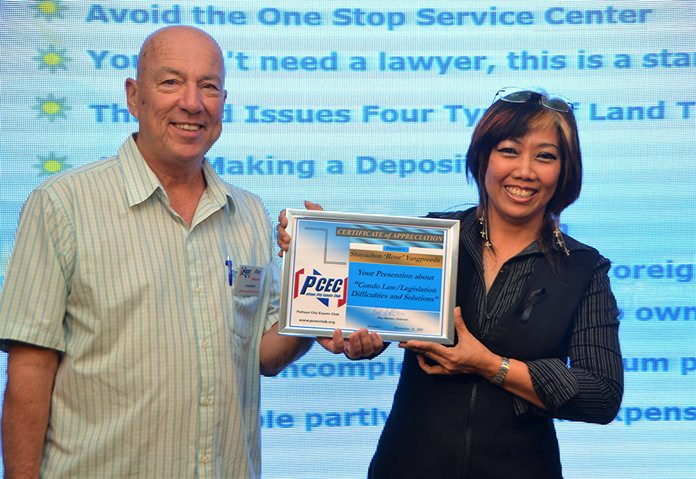 MC Roy Albiston presents the PCEC's Certificate of Appreciation to Rose Yangpreeda for her informative talk about some of the pitfalls of purchasing and owning a condominium in Thailand.