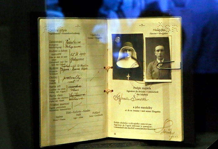 The passport of a Czech agent used to disguise as a nun is displayed as part of the 'Secret Wars' exhibition at Invalides Museum, in Paris, Monday, Dec. 12. (AP Photo/Francois Mori)