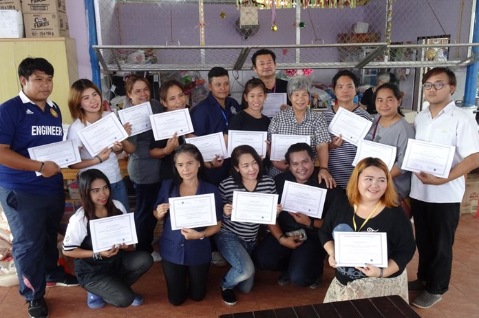 Staff at the Centre with their certificates.