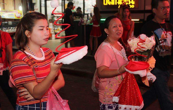 Vendors were doing brisk business selling Santa gear on Walking Street.