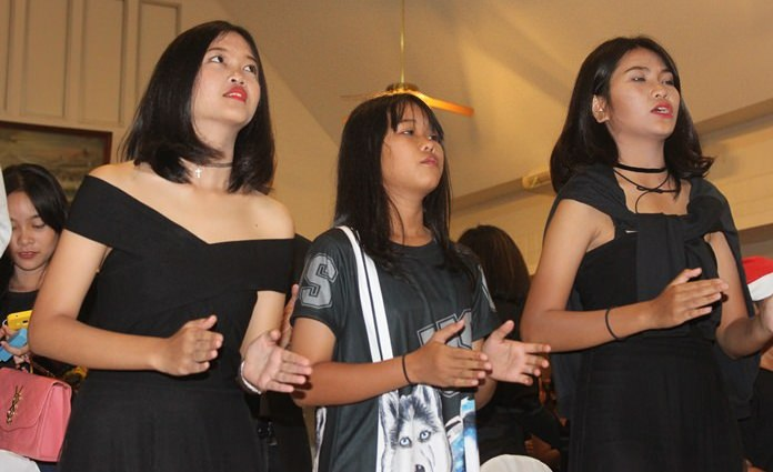 Singing carols in church is a cherished tradition for many worshippers.