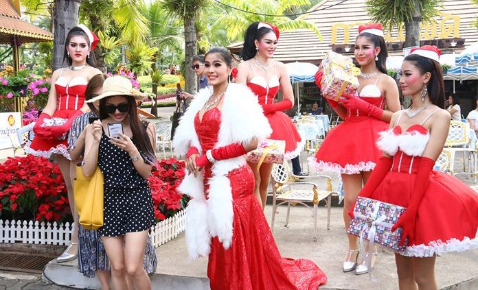 Mrs. Claus with maids in waiting entertain guests at Nong Nooch Tropical Gardens.
