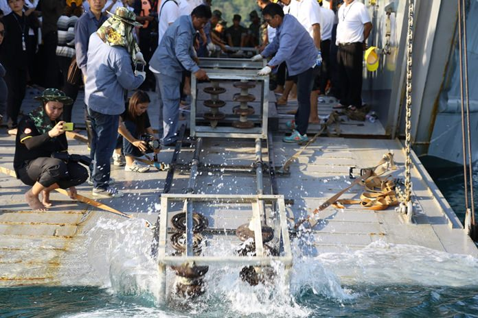 The Electricity Generating Authority of Thailand joined the Royal Thai Navy to create artificial coral reefs by using electrical insulator cups removed from high-voltage transmission towers.