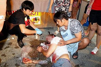 "A foreign man was beaten unconscious by suspected bar bouncers in the Walking Street ""safety zone""."
