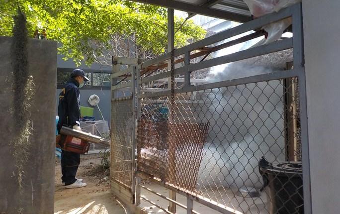 Public health workers spray Soi Khao Talo for mosquitos to prevent dengue fever and Zika.