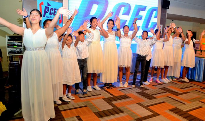 """The children from the Orphanage, dressed in white, were very energetic during their singing of """"So Long, Farewell,"""" from the musical """"The Sound of Music."""""""