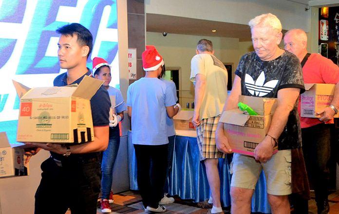 """Several """"strong"""" PCEC members assisted in carrying out the gifts for the children at the Pattaya Orphanage, which were purchased from donations received from members and guests."""