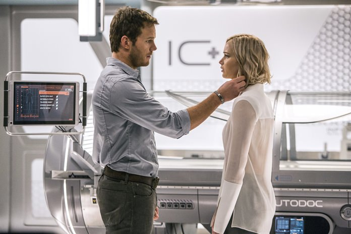 "Chris Pratt (left) and Jennifer Lawrence are shown in a scene from the film ""Passengers."" (Jaimie Trueblood/Columbia Pictures/Sony via AP)"