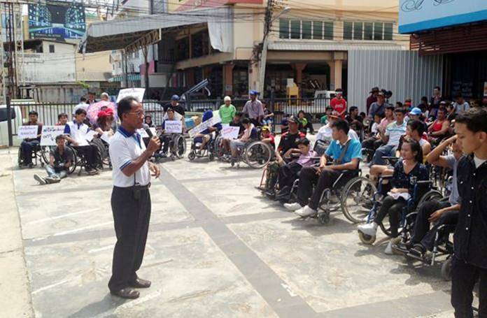 Hundreds of disabled students and residents of four Pattaya communities on May 27 demanded city officials inform them when a long-delayed wheelchair-accessible pedestrian bridge over Sukhumvit Road will be finished.