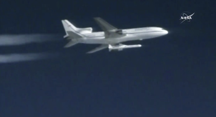 This still image taken from video provided by NASA, a Pegasus rocket containing eight mini-satellites is launched from a plane on Thursday, Dec. 15, 2016, 39,000 feet above the Atlantic, 100 miles east of Daytona Beach, Fla. (NASA via AP)