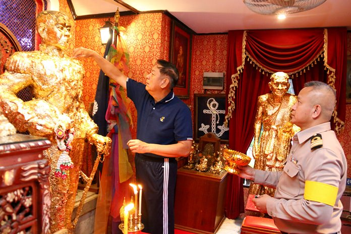 Vice Adm. Nopadol Supakorn places gold leaf on the statue of HRH Abhakara Kiartivongse, the prince of Chumphon.