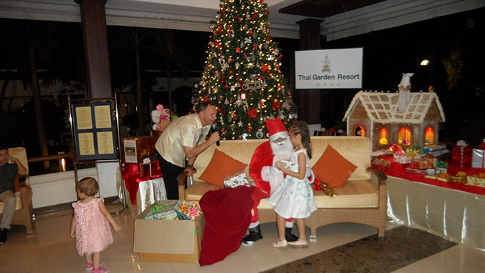The pictures show some of the children receiving their presents from Santa.