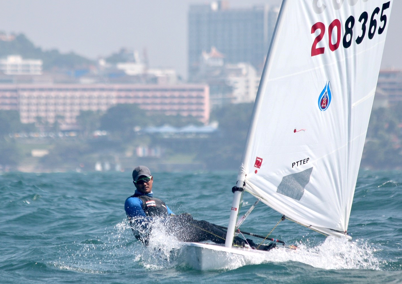 Keerati Bualong leads the Laser Standard fleet heading to the first mark.