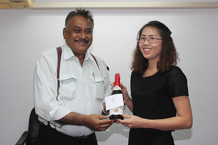 Peter Malhotra presents Nutsara Duangsri with her lucky draw prize - delicious apple juice.