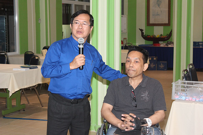 Father Michael introduces Manit Intharapim, a long time resident of the Redemptorist Center, who is now a successful programmer with his own company.