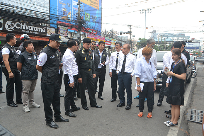 Col. Popanan Luangpanuwat, commander of the National Council for Peace and Order in Banglamung, and Pattaya City Council members walked Second Road from South to Central roads, eyeing changes to parking and pavement.