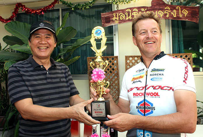 Geir Iversen of Norway (right) receives the trophy from Surakij Kamolrath after winning the 40km race.