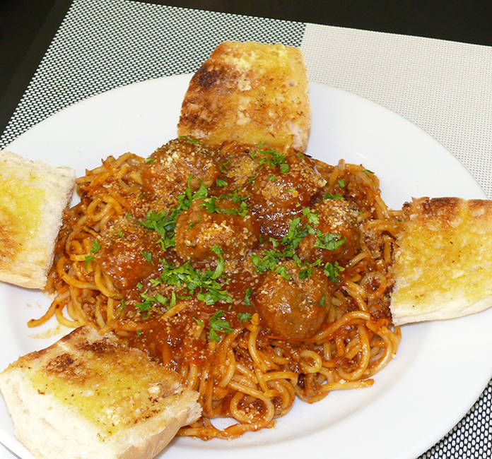 A huge plate of spaghetti and meatballs.