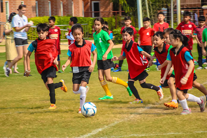 Children run off some of their energy in the mixed gender football match.
