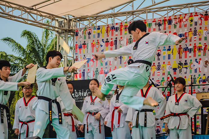 Students perform Taekwondo during the martial arts demonstration.