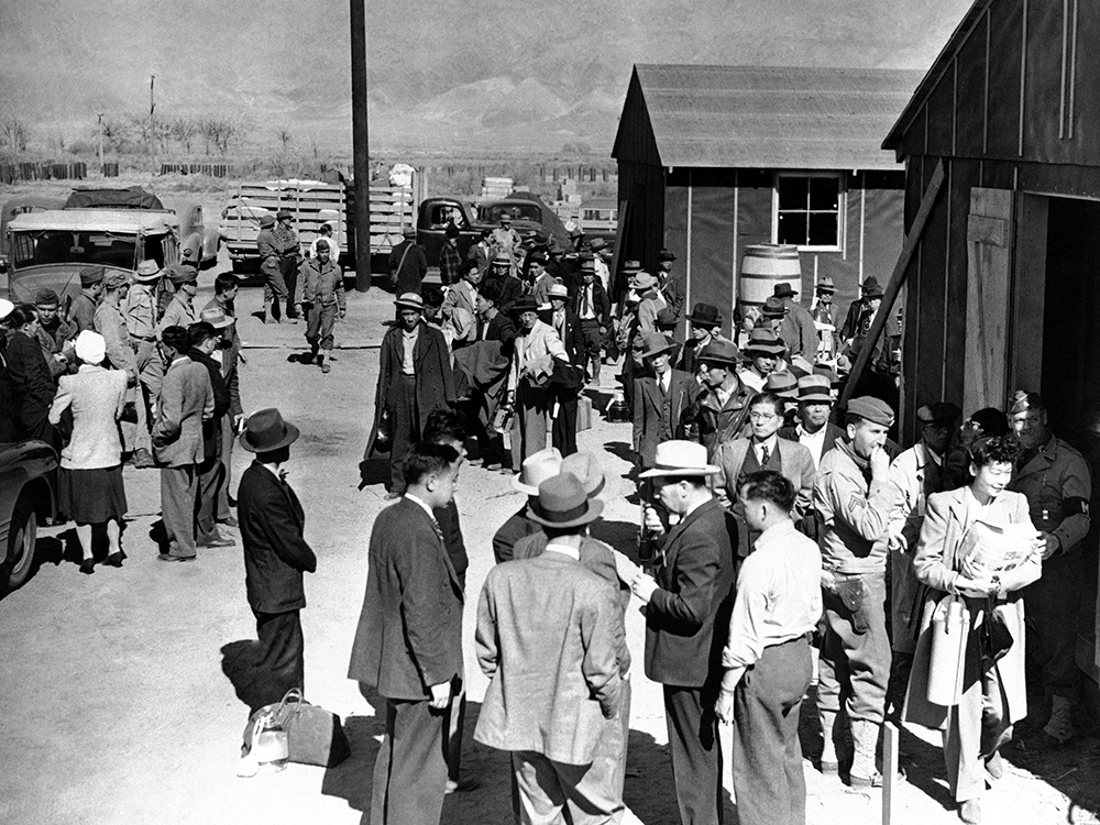 This March 23, 1942 file photo shows the first arrivals at the Japanese evacuee community established in Owens Valley in Manzanar, Calif., part of a vanguard of workers from Los Angeles. (AP Photo/File)