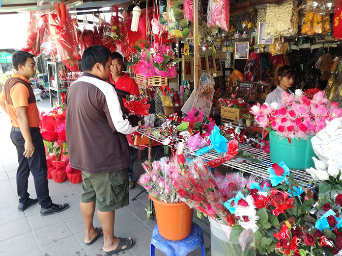 Shops did a booming business selling flowers and dolls.