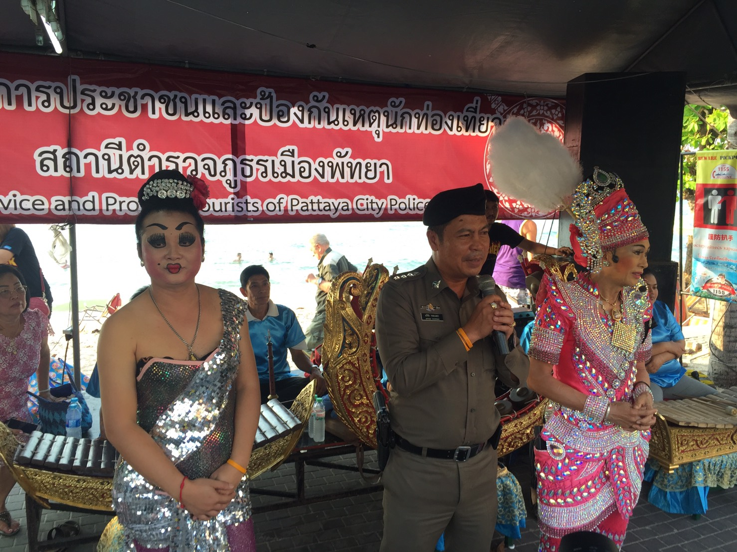 Police Chief Pol. Col. Apichai Krobpetch announces the special Valentine's Day Likay performance by the Pattaya Police at the Tourist Assistance Center on Pattaya Beach Road.