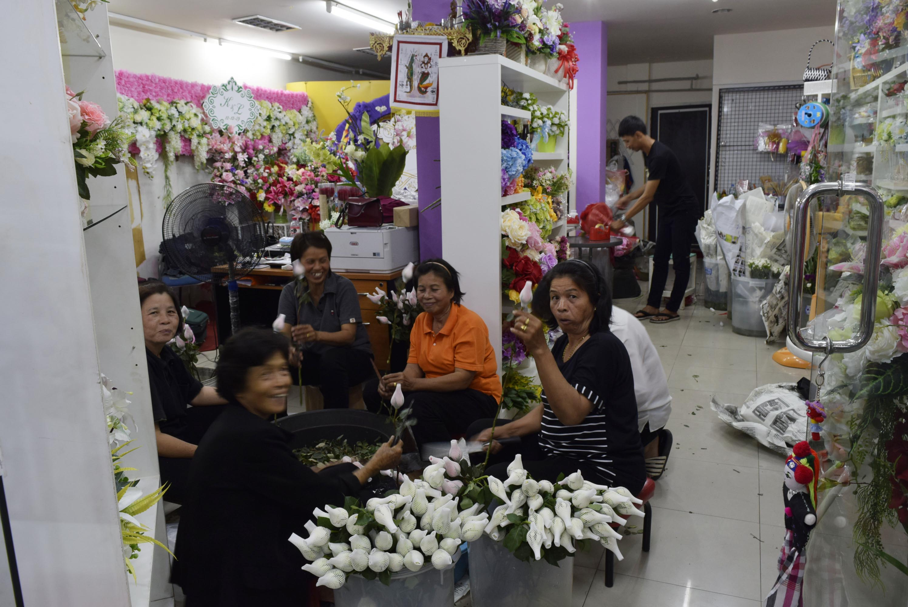 Industrious women are hard at work preparing flowers for Valentine's Day.
