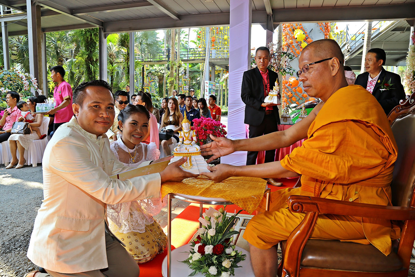 Phra Khru Kasemkithisopon from Wat Samakeebanpoth conducts a religious blessing ceremony a Nong Nooch Tropical Garden.