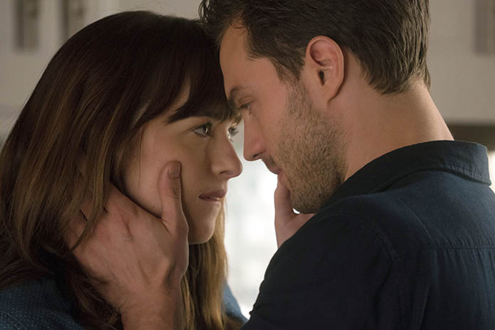 "Dakota Johnson as Anastasia Steele (left), and Jamie Dornan as Christian Grey are shown in a scene from the movie ""Fifty Shades Darker."" (Doane Gregory/Universal Pictures via AP)"