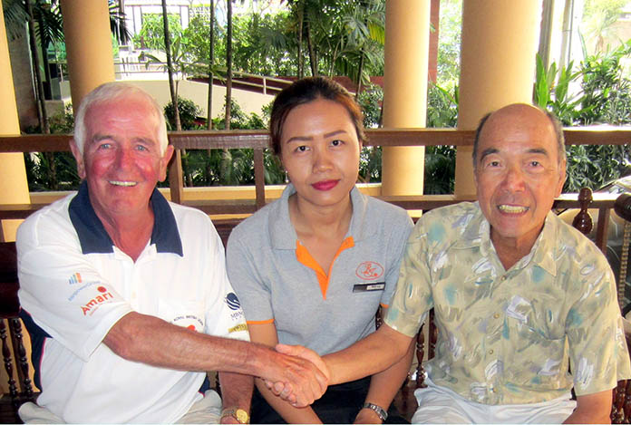 Dave Cooper (left) and Mashi Kaneta (right) with one of BJ Lodge's staff members.