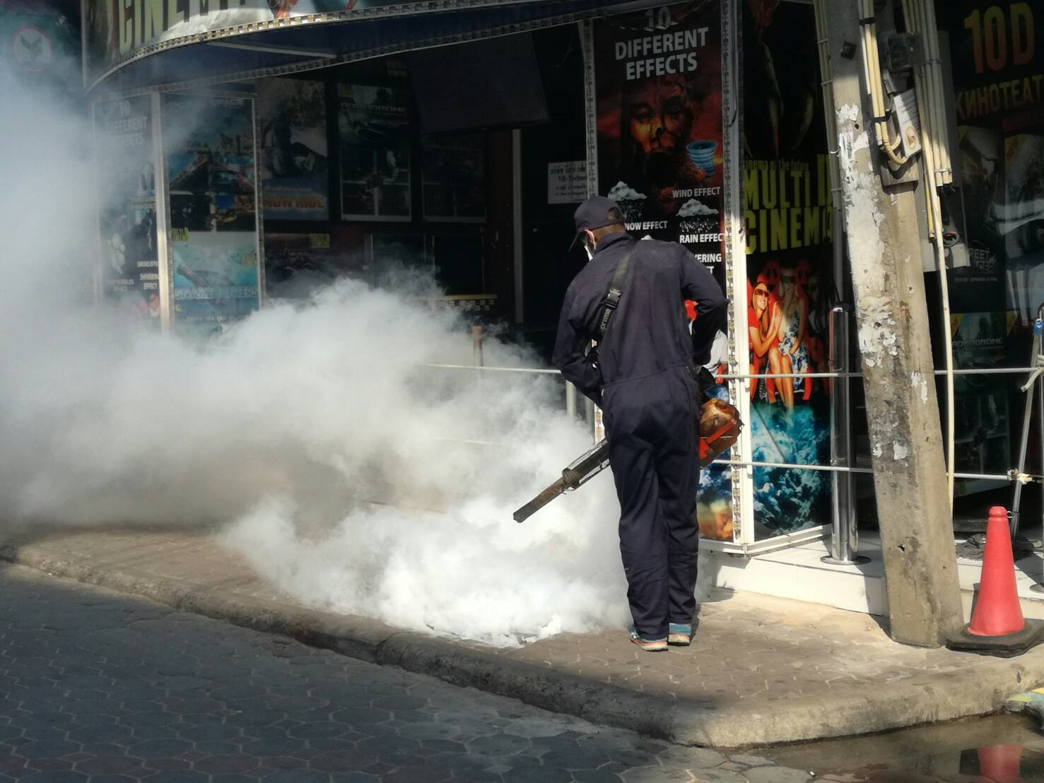 A worker from the Pattaya Health Department sprays pesticide around Walking Street.