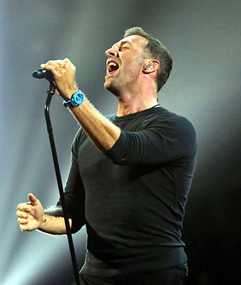 Chris Martin performs a George Michael song on stage at the Brit Awards 2017 in London, Wednesday, Feb. 22. (Photo by Joel Ryan/Invision/AP)