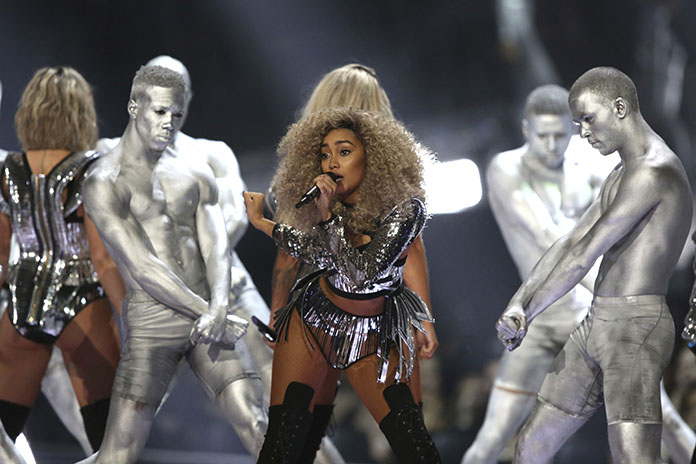 Singer Leigh-Ann Pinnock of the group Little Mix performs on stage at the Brit Awards in London. (Photo by Joel Ryan/Invision/AP)