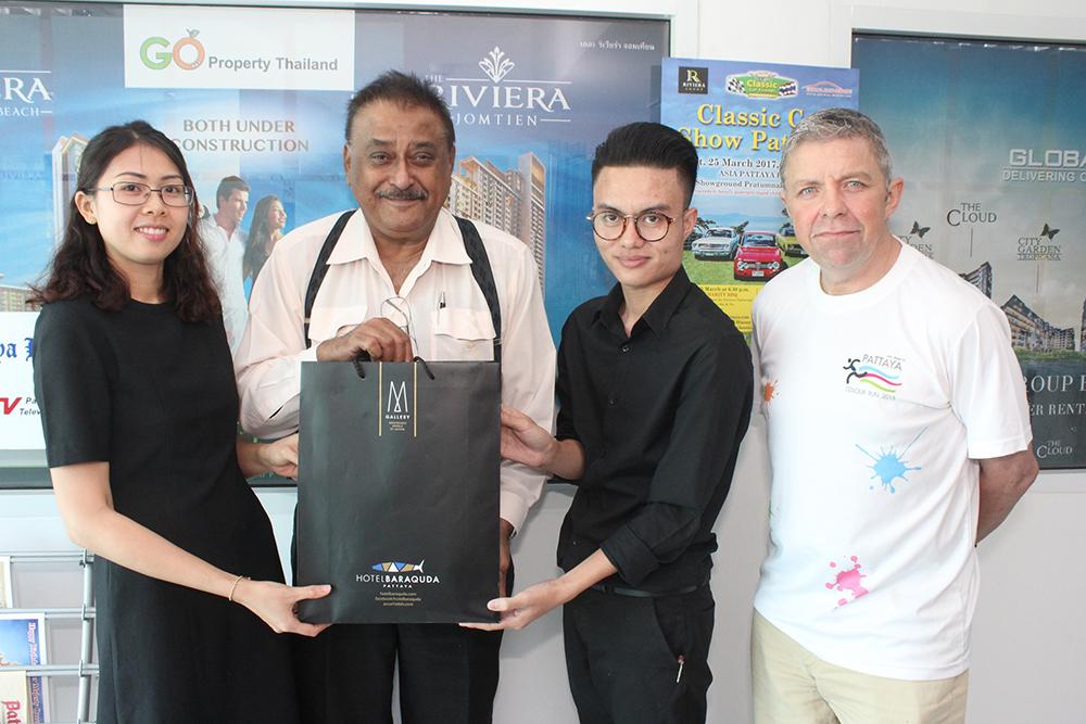 Representatives from Hotel Baraquda wish Peter a happy 65th birthday.