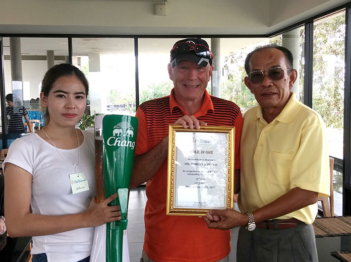 Bob Poole (centre) holds his certificate after his hole in one at Pattavia on Monday.