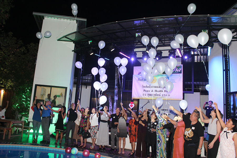 Rotarians and guests release white balloons as a symbol of peace for all mankind.