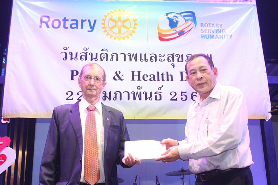 Asst. Gov. Joseph Roy makes his contribution to the cause.