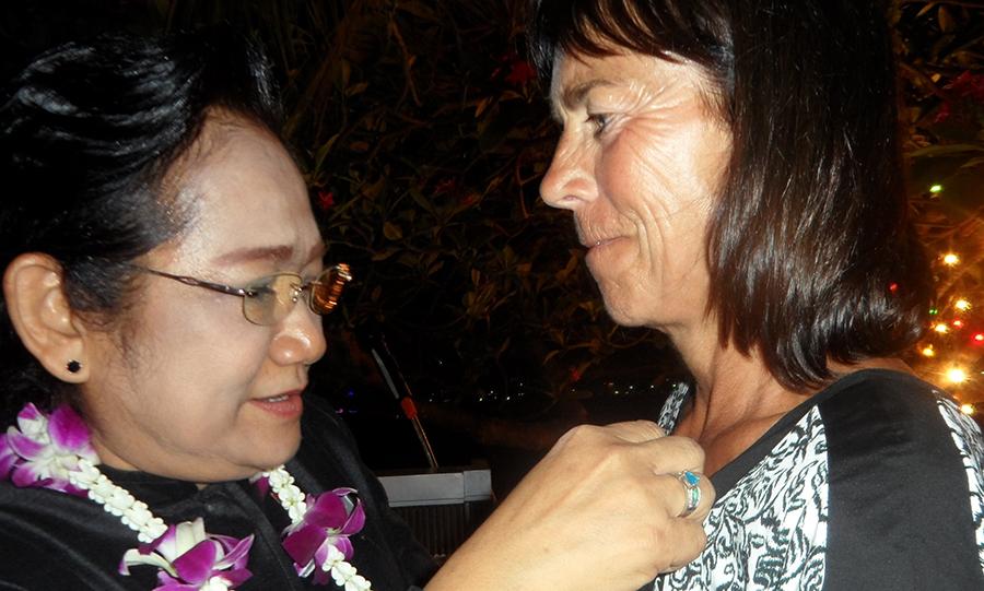 DGE Onanong Siripornmanut presents the Paul Harris Fellow pin to Renee de Vaans.