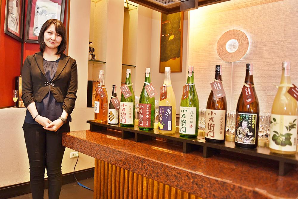 Naoko Saito from BB&B Co., Ltd., beside the nine premium sake's from Kozaemon.