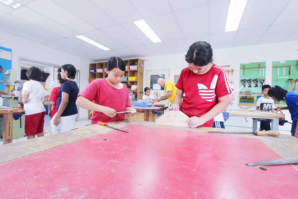 Concentrating hard, students made their own boomerangs.