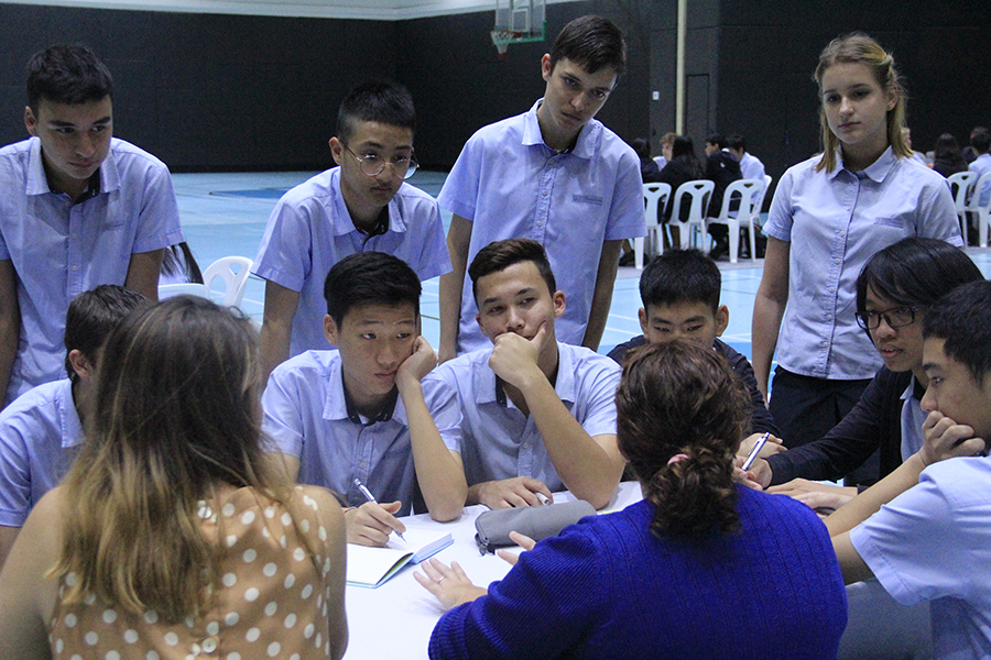 Students listen to professionals from the IT industry.
