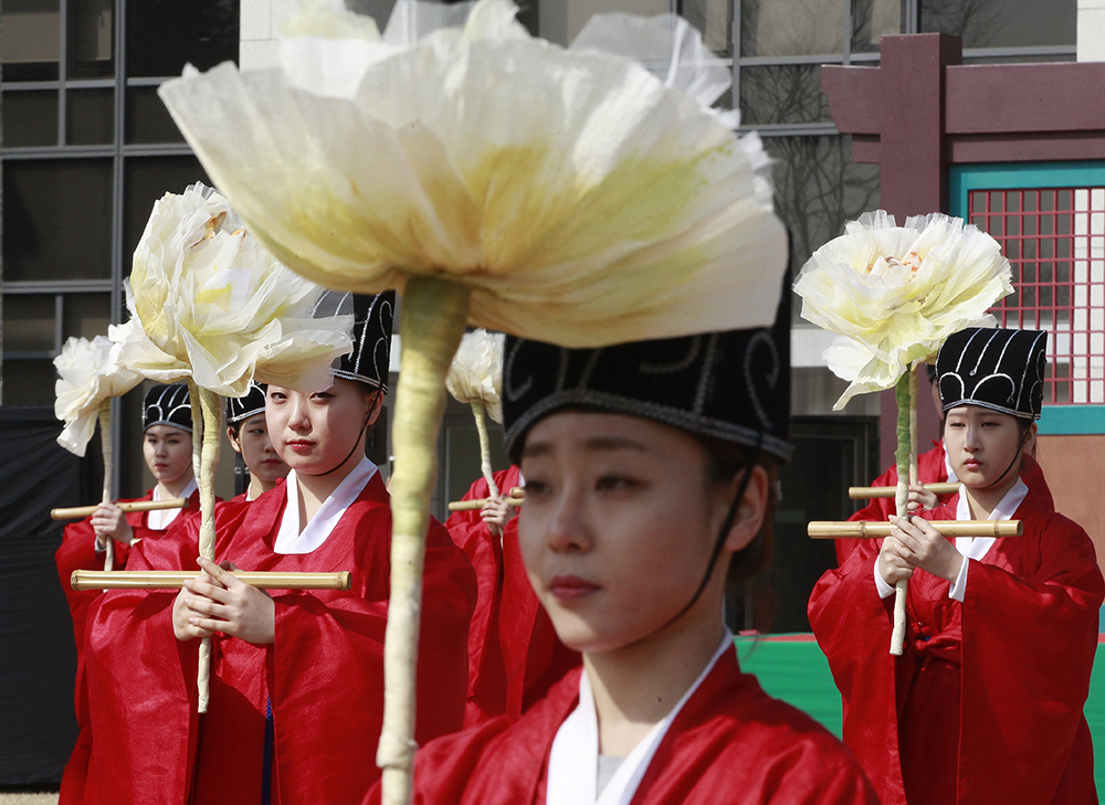 South Korean students wearing traditional Korean costumes perform during a graduation ceremony at Sungkyunkwan University in Seoul, South Korea. Most people born in rich countries will live longer by 2030, with women in South Korea projected to reach nearly 91, a new study published online Tuesday, Feb. 21, 2017 predicts. (AP Photo/Ahn Young-joon, File)